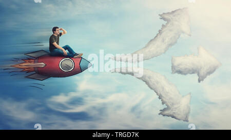 Guy flying on a fast rocket ship, hand to forehead looking far away for destination, has to choose a way as cloud arrows leads to three different dire - Stock Photo