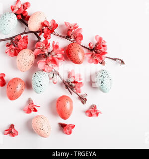 Easter greeting card background with japanese quince flowers and eggs. Holiday composition on white background. Spring arrangement and design element,
