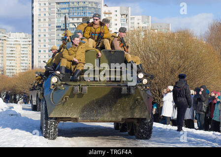SAINT-PETERSBURG, RUSSIA - FEBRUARY 17, 2019: Soviet soldiers on an armored personnel carrier BTR-80. Fragment of the military-historical festival 'Af - Stock Photo
