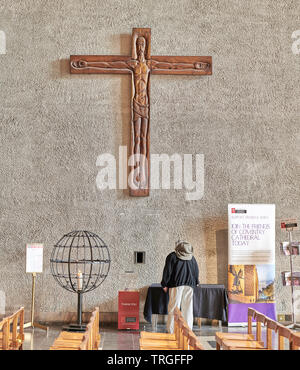 Wooden carved crucifix on the east wall of the cathedral of Coventry, England.