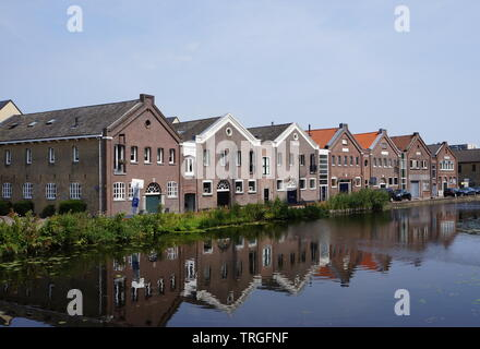 Old warehouses in the historical city center of Schiedam, not far from Rotterdam, in the province of South Holland in the Netherlands. - Stock Photo