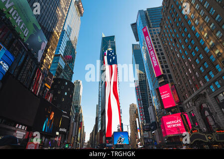 New York City/USA, May 27, 2019.  Neon Lights on Times Square, American Flag Neon Light. Street View, Skyscrapers, Patriotism. - Stock Photo