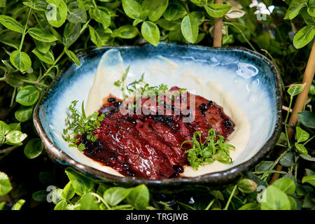 sliced beef steak with red sauce - Stock Photo