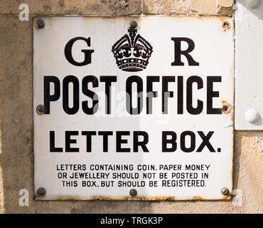 Enamel sign G R Post Office Letter Box in Lauder, Scotland, UK - Stock Photo
