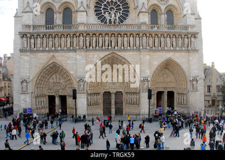 Crowds in front of Notre Dame cathedral, Paris, France - Stock Photo