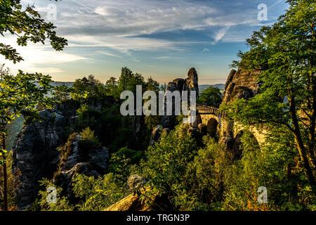 view on the bastion bridge at sunrise in saxon switzerland, germany - Stock Photo