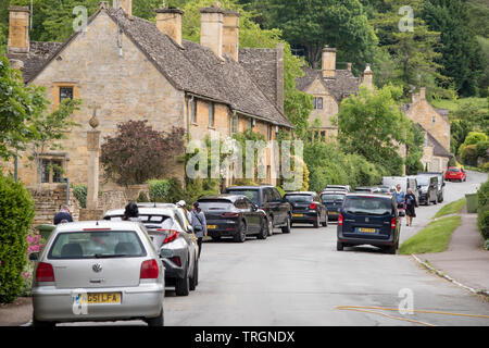 The Cotswold village of Stanway congested with parked cars, Worcestershire, England, UK - Stock Photo
