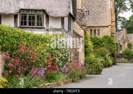 Thatched cottages in the Cotswold village of Stanton, Worcestershire, England, UK - Stock Photo