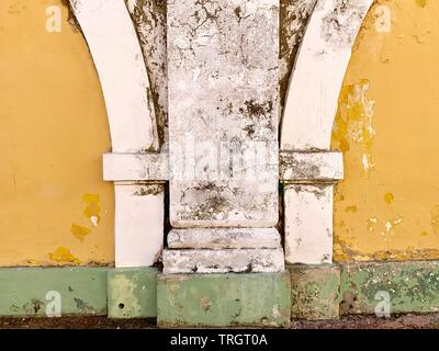 Details on old yellow white and green painted building exterior - Stock Photo