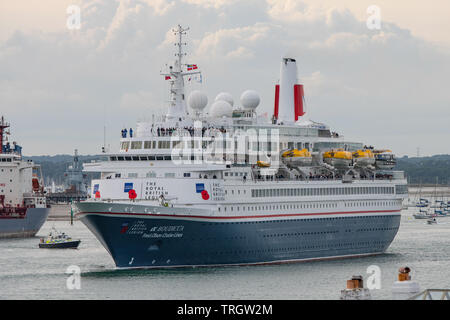 The cruise ship MV Boudicca, chartered to carry D Day veterans to the Normandy Beaches, leaves Portsmouth, UK on 5/6/19 escorted by navy ships. - Stock Photo