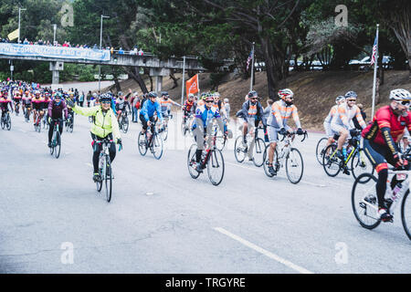 San Francisco, USA. 2nd June, 2019. Cyclists with fans cheering them on as they leave the Cow Palace at the start of the AIDS/Lifecycle. - Stock Photo