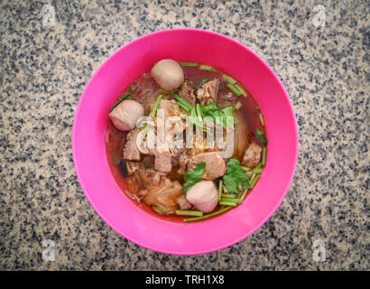 Noodles soup bowl with pork meat ball and vegetables traditional thai and chinese style food of asian - Stock Photo