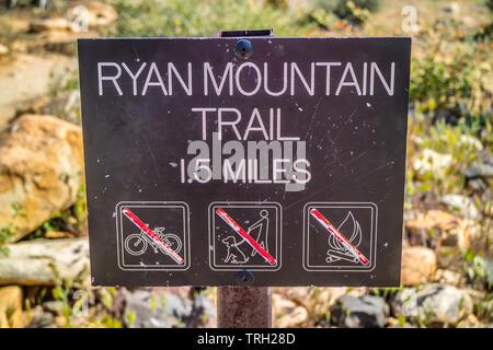 Joshua Tree NP, CA, USA - April 21, 2017: A direction to Ryan Mountain hike trail - Stock Photo