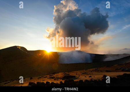 Erupting Mt Yasur Volcano at sunset, Tanna Island, Vanuatu - Stock Photo