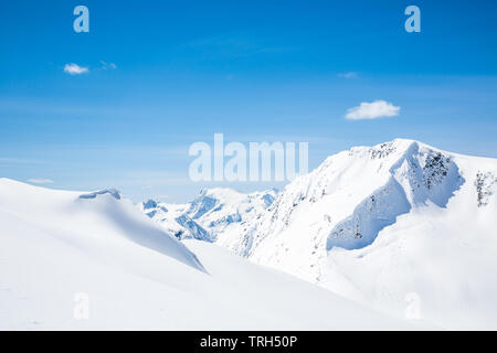 Backcountry skiing with new spring snow in the Canadian Rocky Mountains of Glacier National Park near Golden, British Columbia. - Stock Photo