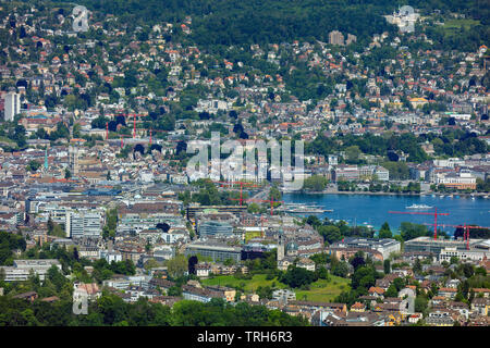 Zurich, Switzerland - June 5, 2019: the city of Zurich as seen from Mt. Uetliberg. The Uetliberg is a mountain rising to 870 m and offering a panorami - Stock Photo
