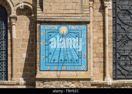 vertical wall sundial on Ely Cathedral with greek words of Pittacus saying 'know the time' or 'recognise an opportunity', England, uk - Stock Photo