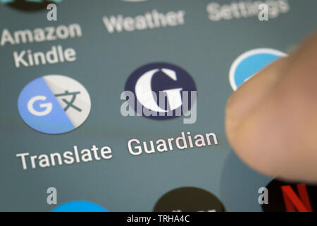 Guardian logo icon on mobile phone screen - Stock Photo