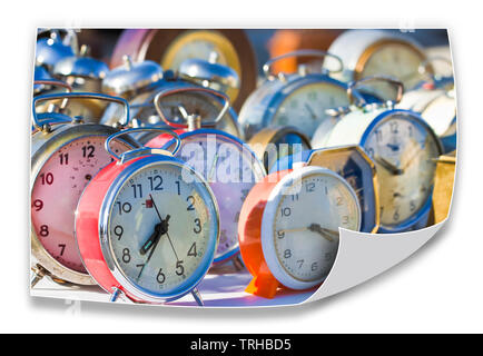 Time passes inexorably - Old colored metal table clocks - concept image - Stock Photo