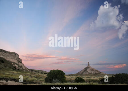Chimney Rock National Historic Site in early morning, western Nebraska, USA. The peak of Chimney Rock is 1289 meters above sea level. - Stock Photo