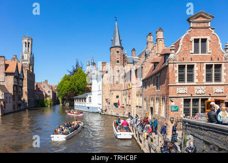 Iconic view Tourists in boats for boat trips leaving from the Rozenhoedkaai Rozenhoedkai Quay of the Rosary Den Dijver canal Bruges Belgium EU Europe - Stock Photo