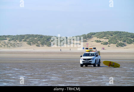 RNLI lifeguards on Camber Sands beach, UK - Stock Photo