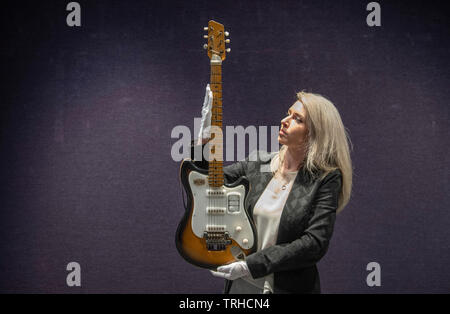 Bonhams, London, UK. 6th June 2019. George Harrison's Futurama electric guitar, c 1958, on display at Bonhams Entertainment Memorabilia sale preview Knightsbridge for sale on 12th June. Estimate £200,000-300,000. This historically important guitar, which comes in its original case embellished with Hamburg stickers, has never been seen on the market before; it has impeccable provenance and is extremely well-documented. Credit: Malcolm Park/Alamy Live News. - Stock Photo