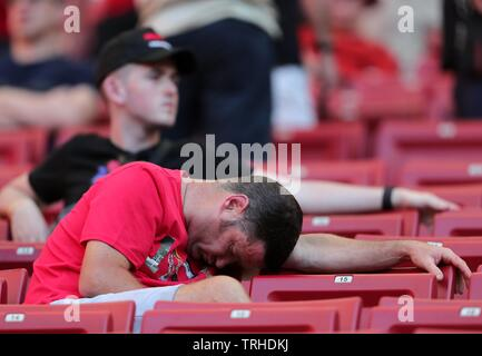 LIVERPOOL FAN ASLEEP IN STANDS BEFORE GAME, TOTTENHAM HOTSPUR FC V LIVERPOOL FC, 2019 - Stock Photo