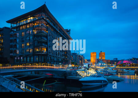 Oslo architecture, night view of waterfront buildings in the harbour district (Aker Brygge) in central Oslo, Norway. - Stock Photo