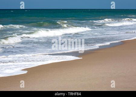 Waves Washing onto Shore - Stock Photo