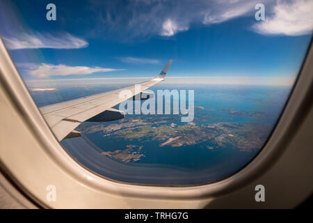Approaching the Bergen airport, looking out of aircraft windows over the wings, on the fjords of Bergen, Blomsterdalen, Kokstad, Hordaland, Norway, Sc - Stock Photo