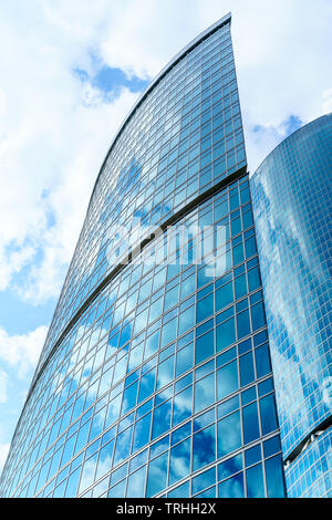 fragment of contemporary architecture, walls made of glass and concrete. Glass curtain wall of modern office building - Stock Photo