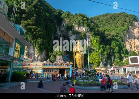 Batu Caves, Kuala Lumpur, 1st May 2019 - Batu Caves temple entrance with world's largest Murugan Statue & colorful stairs - Stock Photo