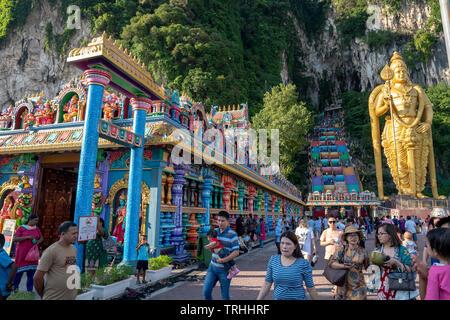 Batu Caves, Kuala Lumpur, 1st May 2019 - Hindu temple with world's largest Lord Murugan Statue & 272 steps colorful stairs - Stock Photo