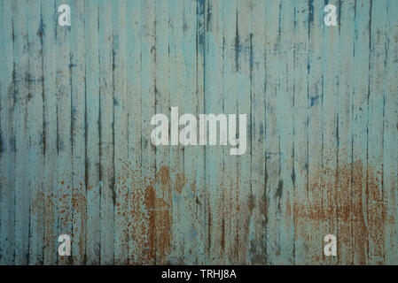Rusty painted metal wall texture background. Light blue grunge / grungy, stripy old corroded surface. - Stock Photo