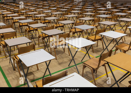 Exam tables and chairs set up in a UK school. - Stock Photo