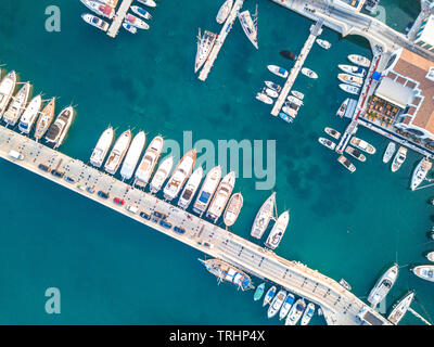 Aerial top down view of boat moored at Limassol New Marina - Stock Photo