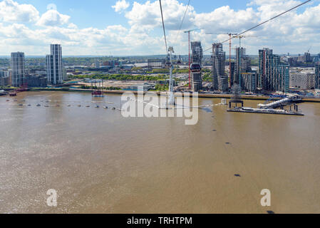 London, UK - May 1, 2018: Gondolas of Emirates Air Line arrive to station at Greenwich Peninsula in eastern London - Stock Photo
