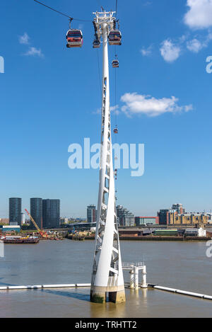 London, UK - May 1, 2018: Gondolas of Emirates Air Line arrive to the station at Greenwich Peninsula in eastern London - Stock Photo