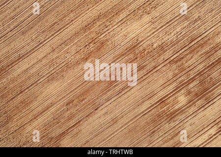 Plowed agricultural field aerial top view. Soil background and texture - Stock Photo