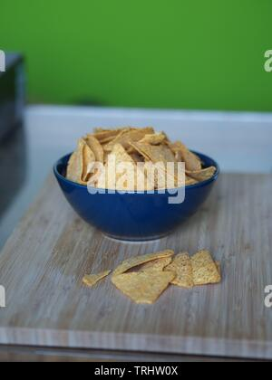 Tortilla chips in a blue bowl tex mex - Stock Photo