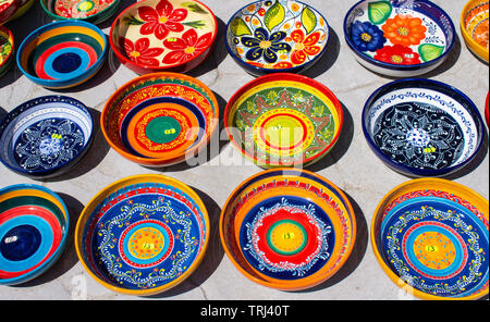 Beautiful coloured hand made and hand painted bowls, from Cuenca Spain. - Stock Photo