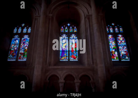 Three stained glass windows in Peterborough Cathedral - Stock Photo