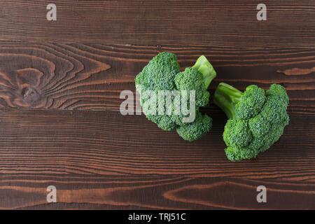 Broccoli on dark wooden background - Stock Photo