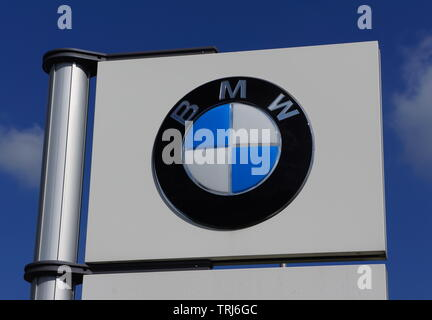 BMW car logo on a sign outside a car dealership, - Stock Photo