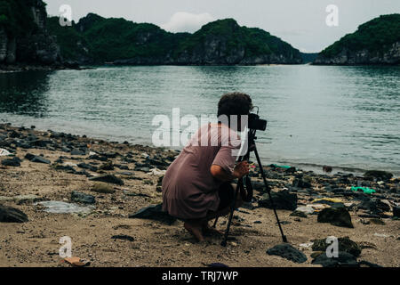 Travel Photographer taking photo of Ha Long Bay - Stock Photo
