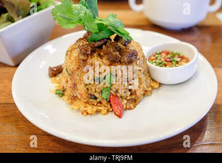 fried rice spicy tom yum sweet pork and chili with vegetable on white plate - Stock Photo