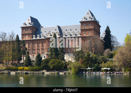 TURIN, ITALY - MARCH 31, 2019: Valentino castle red bricks facade and Po river banks with people in Piedmont, Turin, Italy. - Stock Photo