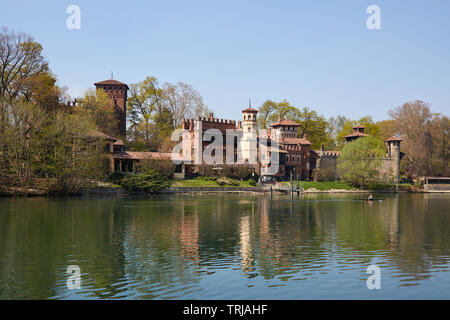 TURIN, ITALY - MARCH 31, 2019: Borgo medievale, medieval village and castle with Po river in a sunny day, man with canoe in Piedmont, Turin, Italy. - Stock Photo