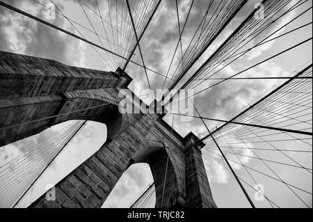 Brooklyn Bridge New York City close up architectural detail in timeless black and white - Stock Photo